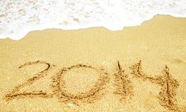 Feiern Sie 2014 auf dem Strand Stockbild