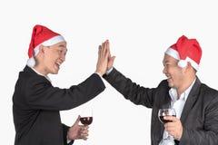 Feiern Sie am Weihnachtstag Lizenzfreie Stockbilder