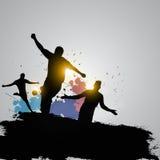 Feiernde Schmutzfußballspieler Lizenzfreie Stockbilder