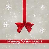 Feiertag bokeh Hintergrund mit rotem Band und Bogen Grußkarte mit Schneeflocken Weihnachtsabstrakter Hintergrund mit Text Lizenzfreies Stockfoto