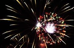Feiertag, Feier - zwei Blitze von bunten Feuerwerken in Lizenzfreie Stockbilder