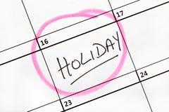 Feiertags-Datum markiert auf einem Kalender. Stockfotografie