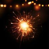 Feiertags-Hintergrund mit Wunderkerze Stockfotos