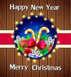 Feiertags-Karteweihnachtsgrußkarte auf hölzernem Hintergrund Stockfoto
