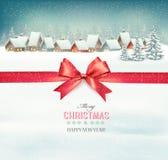 Feiertags-Weihnachtshintergrund mit einem Dorf und einem roten Bogen Stockbild