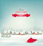 Feiertags-Weihnachtshintergrund mit einem Dorf und einem Sankt-Hut Stockbild