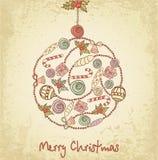 Feiertagskugel mit Weihnachtsfeld Stockfotos