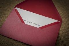 Feiertagsvektorabbildung mit Umschlag, Papier, Tanne und Stechpalme Stockfotografie