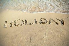 Feiertagszeichen auf dem Strand von karibischem Meer Stockfoto