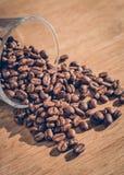 Feijão de café no vidro Imagens de Stock Royalty Free