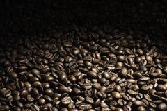 Feijão de café para desvanecer para fora o fundo imagens de stock royalty free