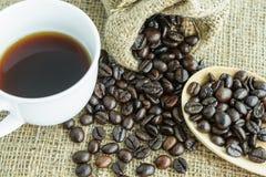 feijão e xícara de café de café Imagens de Stock Royalty Free