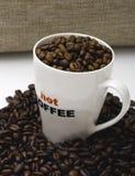 Feijões, caneca e saco de café Fotografia de Stock