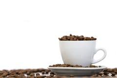 Feijões da chávena de café Fotografia de Stock