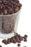 Feijões de café com vidro Imagens de Stock