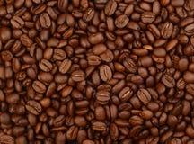 Feijões de café como um fundo Fotos de Stock