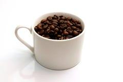 Feijões de café e copo de Coffe Imagem de Stock Royalty Free