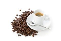 Feijões de café e copo do café Foto de Stock Royalty Free