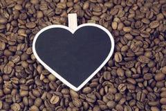 Feijões de café e quadro Imagens de Stock Royalty Free