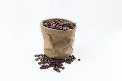 Feijões de café e sacos de café Imagem de Stock Royalty Free