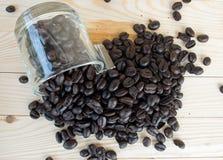 feijões de café e vidro do café Imagem de Stock Royalty Free