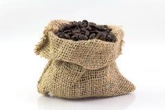 Feijões de café em um saco Fotografia de Stock