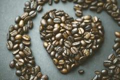 Feijões de café na forma do coração Imagens de Stock