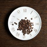 Feijões de café na placa Imagem de Stock Royalty Free