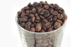 Feijões de café no vidro Fotos de Stock Royalty Free