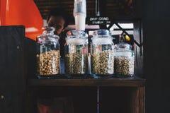 Feijões de café nos frascos de vidro Imagens de Stock Royalty Free