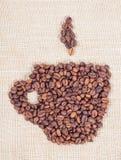 Feijões de café sob a forma do copo Foto de Stock Royalty Free