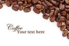 Feijões de café sobre o branco com espaço do texto Fotos de Stock Royalty Free