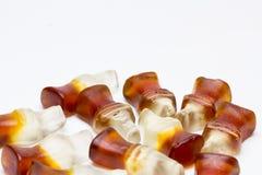 Feijões de geleia na forma de uma garrafa da cola Fotografia de Stock Royalty Free