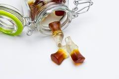 Feijões de geleia na forma de uma garrafa da cola Fotos de Stock Royalty Free