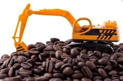Feijões do Backhoe e de café Imagem de Stock