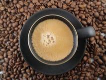 Feijões do copo e de café do café Imagem de Stock