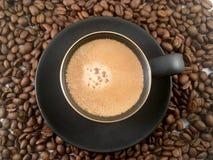 Feijões do copo e de café do café Imagens de Stock