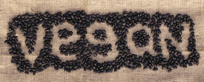 Feijões pretos que formam o vegetariano da palavra Foto de Stock