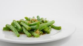Feijões verdes fritados do estilo agitação tailandesa Foto de Stock