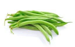 Feijões verdes no fundo branco Fotos de Stock