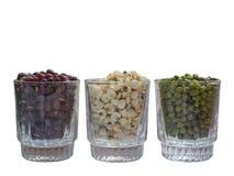 Feijões verdes, feijões vermelhos e painço no vidro Foto de Stock Royalty Free