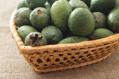 Feijoa fruit in the wicker basket. On a linen background Royalty Free Stock Photo