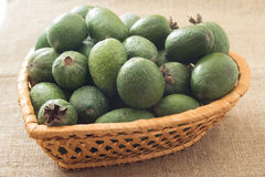 Feijoa fruit in the wicker basket. On a linen background Royalty Free Stock Images
