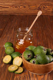 Feijoa Fruits and Bank of honey on a table Royalty Free Stock Photography