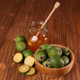 Feijoa Fruits and bank of honey Royalty Free Stock Images