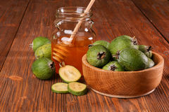 Feijoa Fruits and bank of honey Royalty Free Stock Photo