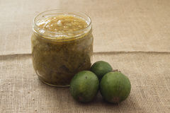 Feijoa jam in a glass jar. On a linen background Royalty Free Stock Photography
