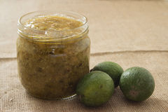 Feijoa jam in a glass jar. On a linen background Stock Image
