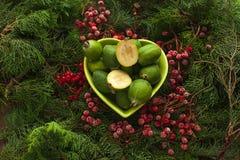 Feijoa source of iodine and vitamins. Feijoa source of iodine and vitamins for a healthy diet. Bowl full of feijoa, exotic fruit stock photos