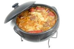 Feijoada. Brazilian typical food, Feijoada in a mud pot royalty free stock images